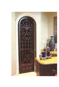 Wrought Iron Wine Cellar Arched Door - mediterranean - interior doors - miami - DecoDesignCenter.com
