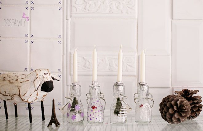 advent candles using clear bottles with little winter scenes in them.  A quirky take on an advent wreath.  via dosfamily