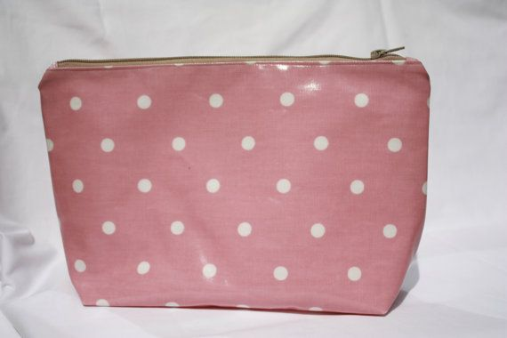 Pink wash bag/toiletry bag/ make up bag, pink polka dot oilcloth wash bag with white lining. Ideal for those well deserved holidays. They all have