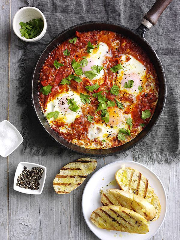 The classic brunch dish shakshuka is vegetarian and quick and easy to make - spices, peppers, tomatoes and eggs bubbled up in a pan - what's not to like?