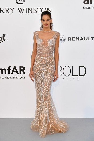 Brazilian model Izabel Goulart poses as she arrives for the amfAR's 24th Cinema Against AIDS Gala on May 25, 2017 at the Hotel du Cap-Eden-Roc in Cap d'Antibes, France. / AFP PHOTO / ALBERTO PIZZOLI