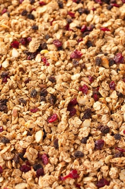 4 cups whole oats (DON'T use quick oats) 1 cup sliced or slivered almonds 1/2 cup packed light-brown sugar 1/4 cup honey 2 Tbsp water 1 1/4 tsp ground cinnamon 1 pinch ground nutmeg 1/2 tsp salt 1 tsp vanilla extract 1/4 tsp baking soda 1 cup dried berries such as blueberries, cranberries, or raisins*, optiona