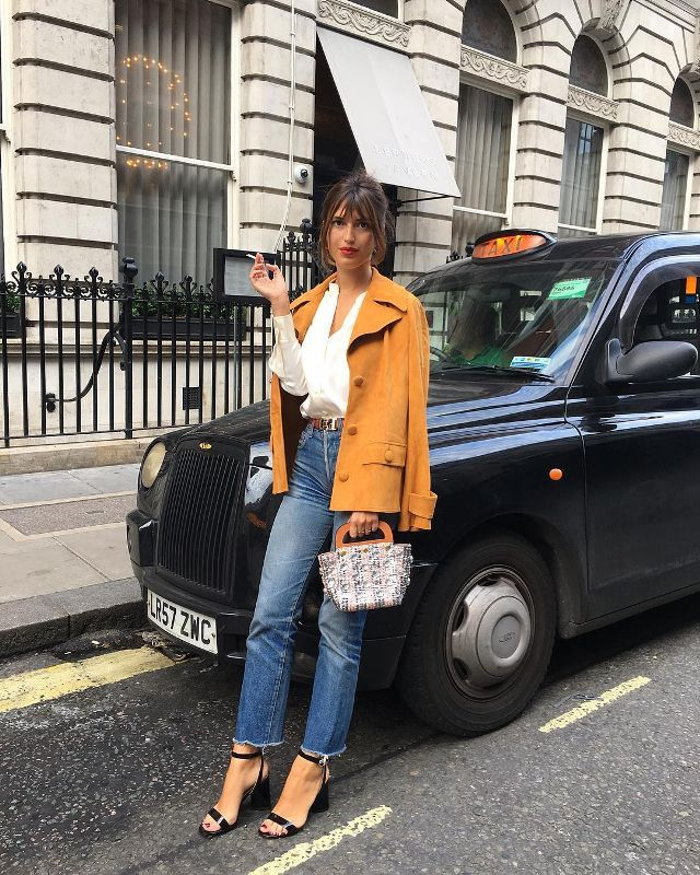 Jeanne Damas in jeans and yellow jacket