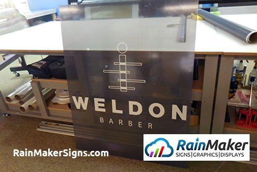 perforated window vinyl display for weldon barber Redmond WA Rainmaker Signs.jpg