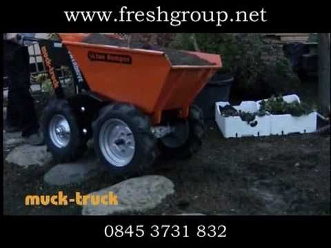 Muck Truck going through rough terrain. The 4WD Muck Truck Power Barrow moves building materials over most terrains. The Muck Truck is used by builders, landscapers and tree surgeons. http://www.fresh-group.com/muck-truck.html