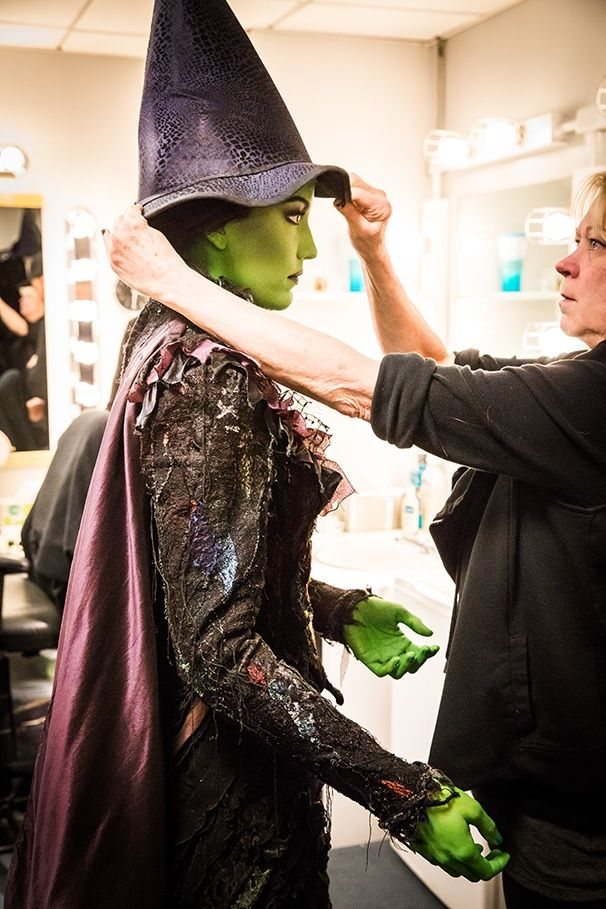 Photo 1 of 19 | Let the greenification begin! Makeup artist Craig Jessup transforms Caroline Bowman into Elphaba. | Exclusive Photos! Go Backstage with Caroline Bowman & Kara Lindsay as They Become Wicked's New Witches | Broadway.com