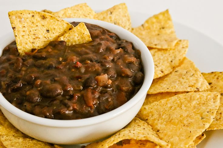 "These ""drunk beans"" may not look interesting, but their beer, bacon and chili ensures the flavor is anything but boring. Try serving frijoles borrachos as a warm soup, a dip, as a side, with grilled tortillas, or as a taco filling."