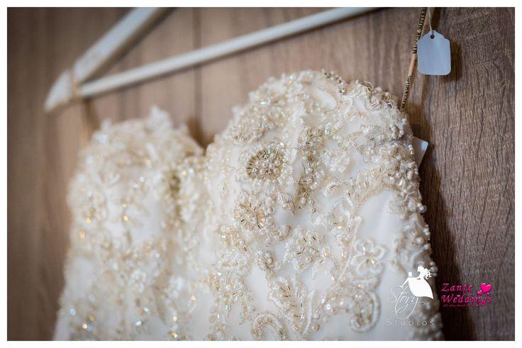 A beautiful sweetheart wedding dress with golden beaded details!