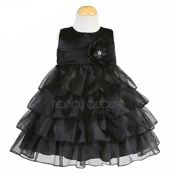 Black Infant #Dress with #Layers and #Layers of Skirt: This black infant dress is classy with a hint of playfulness. The simple sleeveless bodice provides a classic traditional feel while the layers and layers of tiered skirt hints a flirty fun side. A sheer organza waistband is accented with a detachable beautiful matching flower. This fancy black infant dress is versatile and will be perfect for any special occasion such as black tie weddings.