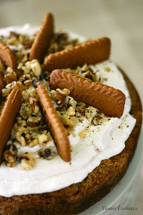 Bisoff Apple Spice Cake Cheesecake with cinnamon whipped cream and chopped walnuts and Biscoff cookies