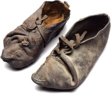 A pair of shoes found together with the bog body from Rønbjerg III dated to the Pre-Roman Iron Age. Photo Roberto Fortuna, The National Museum of Denmark.