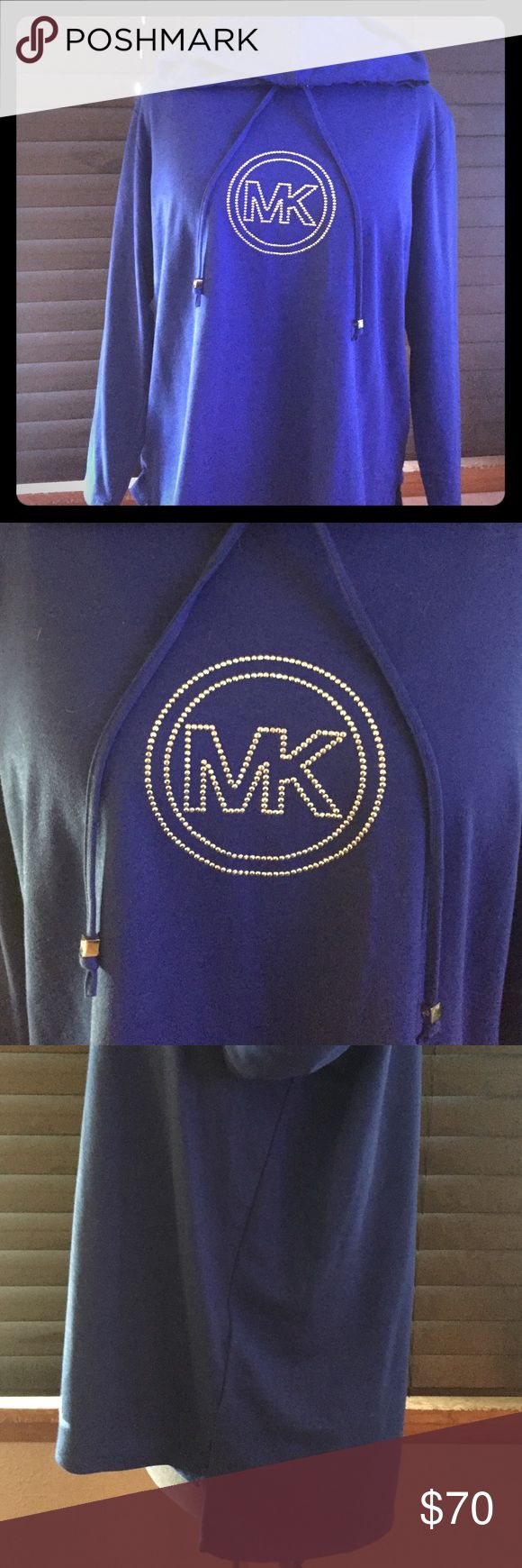 Michael Kors bling light weight sweatshirt. NWT Michael Kors bling light weight sweatshirt. MK logo blinged on the chest, MK logo on toggles of good, hi low design. Cotton / Poly blend so it's more like tshirt material than sweatshirt. I bought it in 3 colors and just haven't wore this one yet. When I have worn the others I got tons of compliments 😎 MICHAEL Michael Kors Tops Sweatshirts & Hoodies