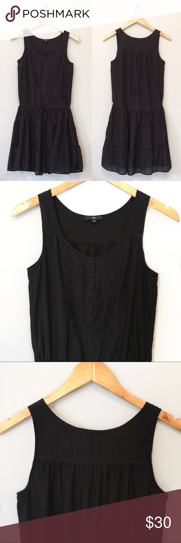 """💟CLEARANCE Gap Dress Cotton-Silk Blend Scoop neck sleeveless Gap dress in Black  Details: ▫️Size XS ▫️Shell 57% cotton 43% silk ▫️Lining 100% cotton ▫️Fully lined ▫️Pull-over style ▫️Pleated front placket with 6 buttons ▫️Cinch tie at waist ▫️Bottom ruffled layers ▫️Machine wash  ▫️Excellent used condition ▫️Pet free/smoke free  Measurements taken flat ▫️Bust 18"""" ▫️Length 35""""  JF.7.17 GAP Dresses"""