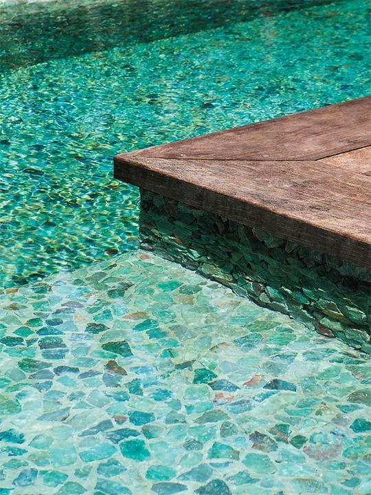 I love the turquoise stone for a pool floor. Such a tropical feeling!  Use in the Master Shower, maybe?