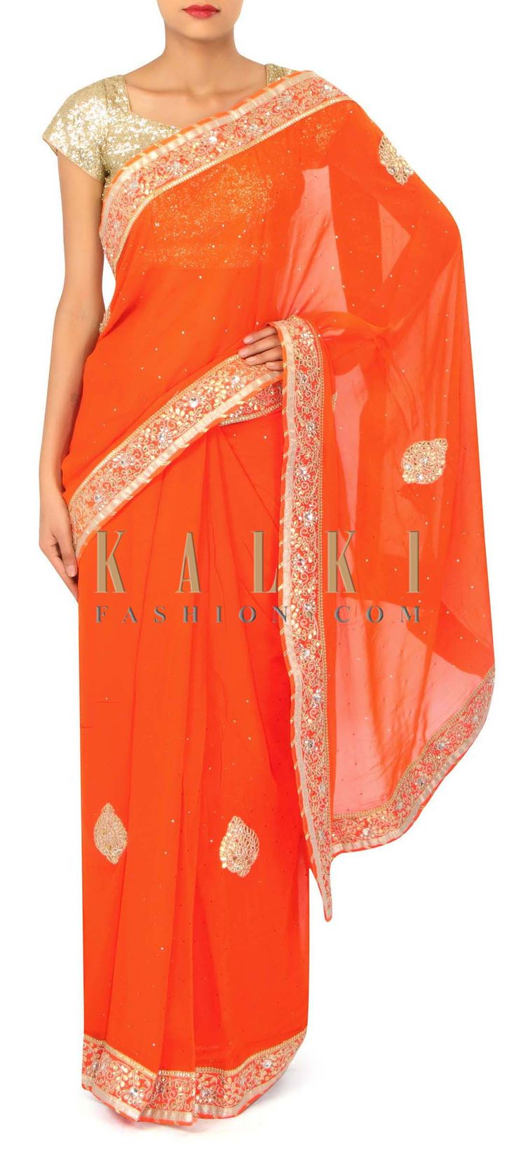 Orange saree adorn in gotta patch embroidery only on Kalki