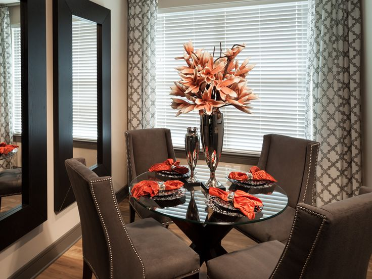 Elegant dinning area in a small space with the vertical mirrors to trick the eye!