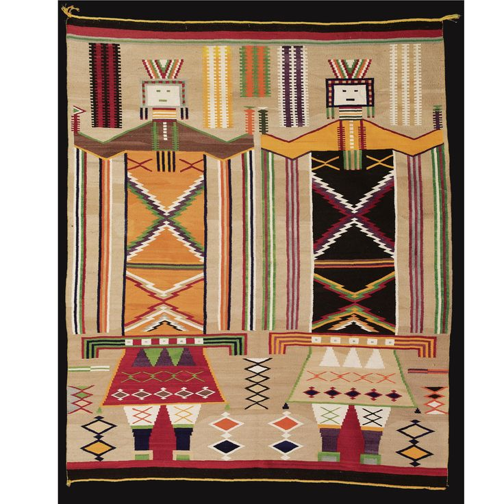 A LARGE NAVAJO TRANSITIONAL RUG    woven in handspun and commercially plied wool, probably Germantown, in natural ivory , tan and dark brown and numerous aniline colors, with two dancing Yei figures.  82 in. by 66 in.