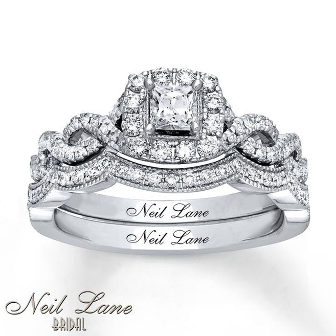 This stunning bridal set from the Neil Lane Bridal® collection features a sparkling princess-cut diamond within a halo of round diamonds. Additional round diamonds line the ring and the matching wedding band, bringing the total diamond weight to 3/4 carat. The bridal set is fashioned in 14K white gold. Each Neil Lane Bridal® diamond ring is hand-crafted and undergoes a four-step polishing process, which gives the ring its beautiful shine and luster. Each ring has Neil L...
