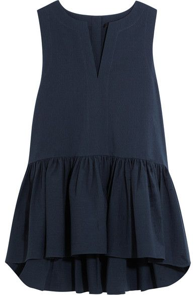 We like the relaxed, low-key feel of Tibis navy top - a cool alternative to fitted peplum styles. Its cut from a crisp seersucker cotton-blend that holds the shape of the pleats perfectly. Team yours with culottes and slides.