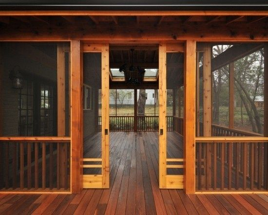 This rustic screened porch features sliding doors that open for a wide walkway. View our home plans with screened porches here http://www.dongardner.com/Screened_Porch_House_Plans.aspx. #ScreenedPorch #Outdoor #Rustic