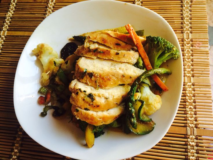 Lemon and herb grilled chicken breast with vege stir fry  Ingredients: chicken breast Chicken breast Garlic Lemon Cayenne pepper Black pepper Salt Olive oil Thyme  Method: mix everything together and marinate meat and grill or roast. And slice for serving.  Vegetable stir fry: Fry any vegetable of your choice like sweet corn, broccoli, onion, carrots, green peas and etc. with sesame oil (  or olive oil or canola oil) drizzle the leftover marinade from the chicken breast.   Enjoy.