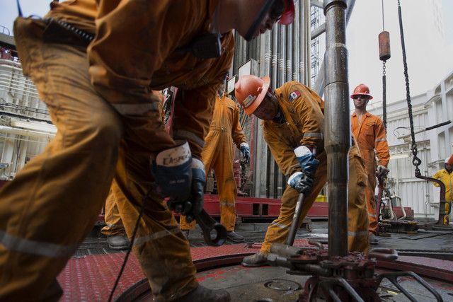 Crude Oil Platform Workers prepare a drilling pipe on the Petroleos Mexicanos La Muralla IV deep sea crude oil platform in the waters off Veracruz, Mexico. The U.S. Energy Information Administration said crude inventories rose by 4 million barrels in the week to Oct. 11. Photographer: Susana Gonzalez/Bloomberg