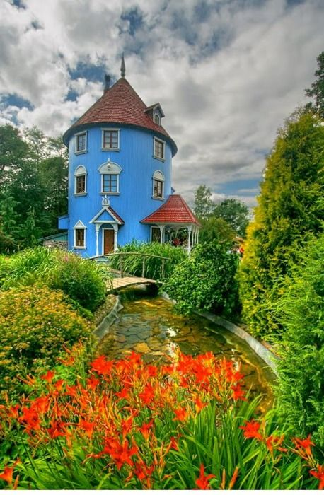 Red wildflowers/Blue house. Moominhouse, Finland