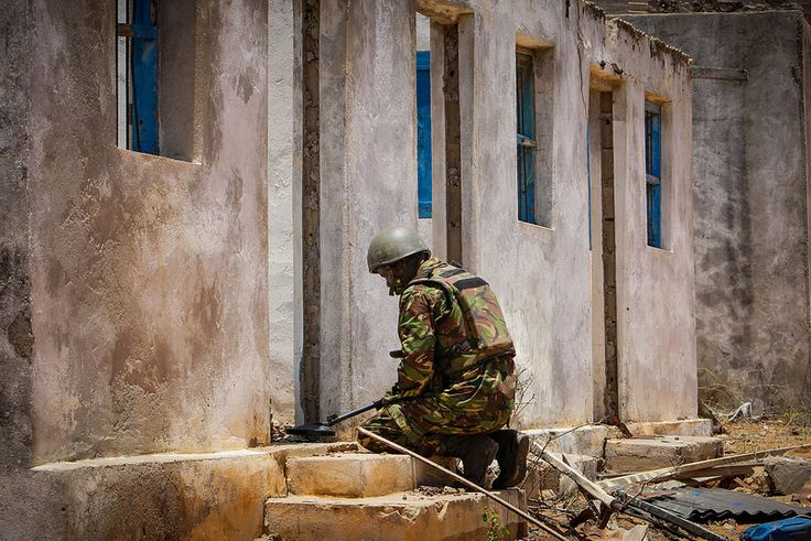 SOMALIA, Kismayo: 06 October, a member of a combat engineering team serving with the Kenyan Contingent of the African Union Mission in Somalia (AMISOM) sweeps the former compound housing the offices of the United Nations High Commission for Refugees (UNHCR) for unexploded ordinace and improvised explosive devices (IEDs) in the southern Somali port city of Kismayo. AU-UN IST PHOTO / STUART PRICE.