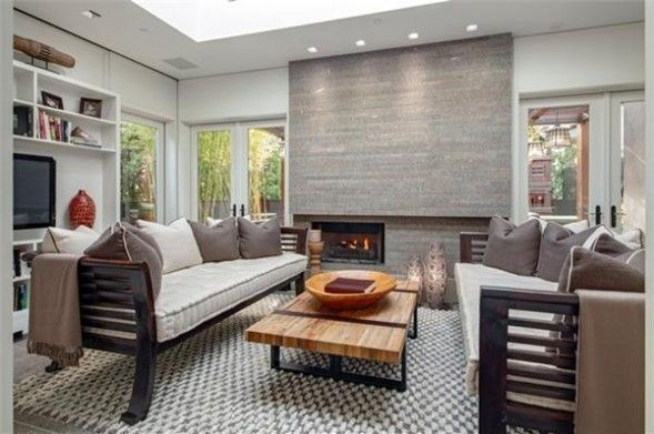 Kelly Ripa's two-year SoHo penthouse renovation cost 9.5 million dollars with high-end perks including stained white oak floors and a statement fireplace. #celebrity #TV #interiordesign