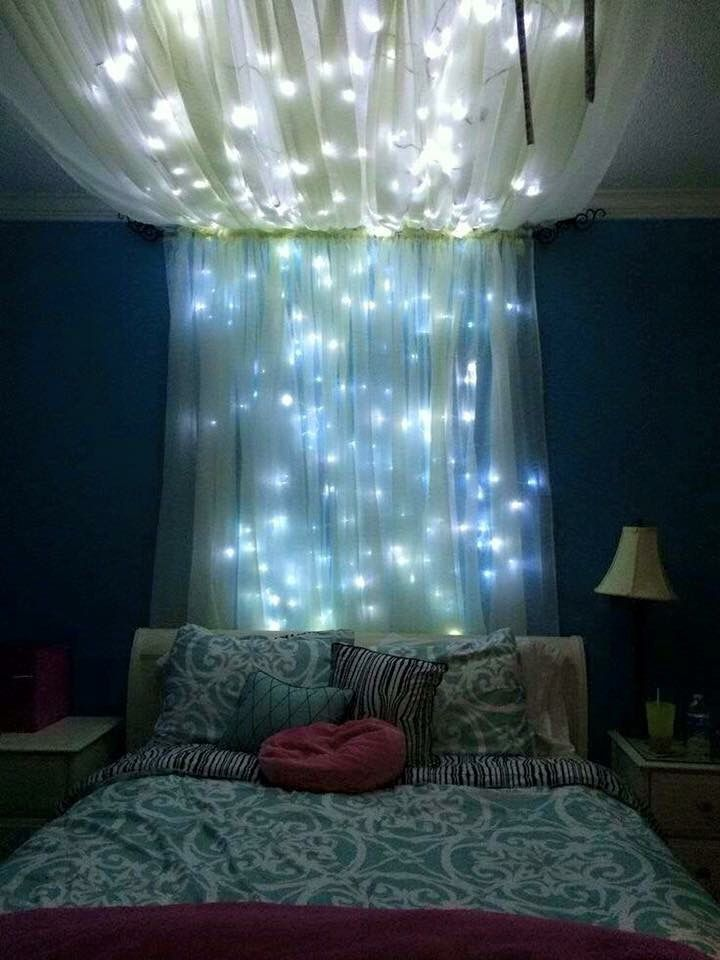 Sparkly lights and curtains above bed 16