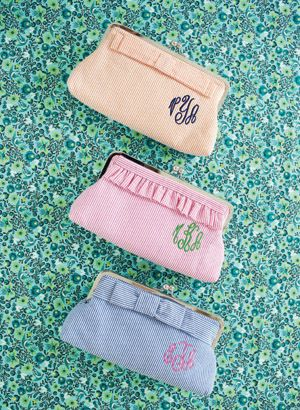 monogram seersucker clutches