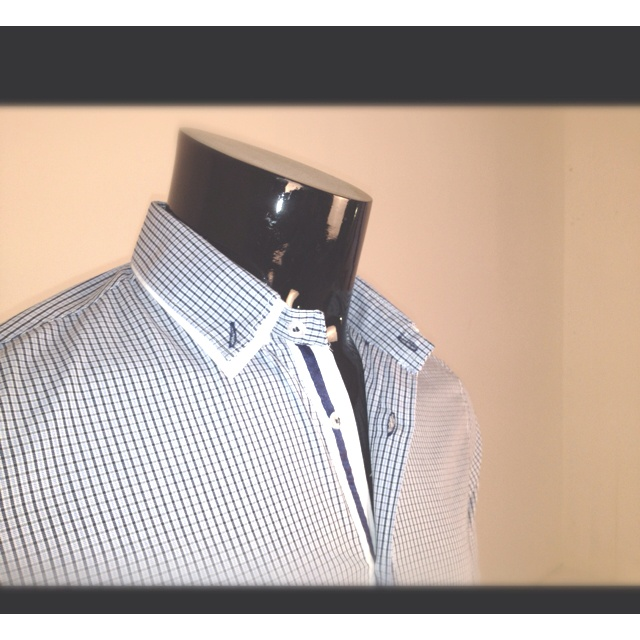 Double collar and placket detail.