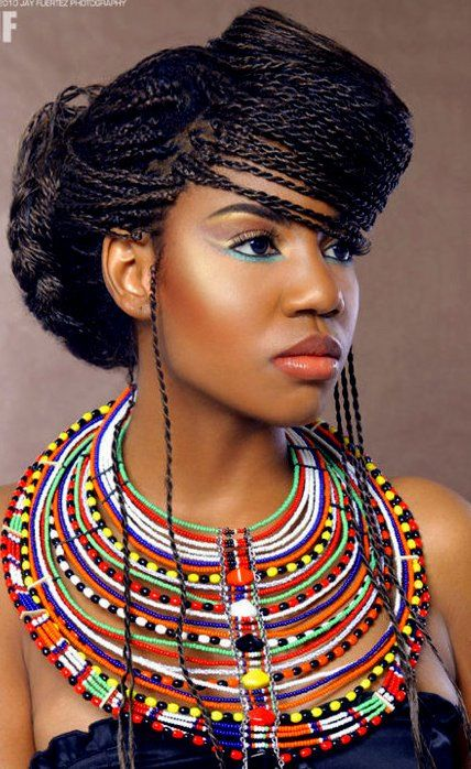 Try sweeping your braids across your forehead to create this afrocentric look!