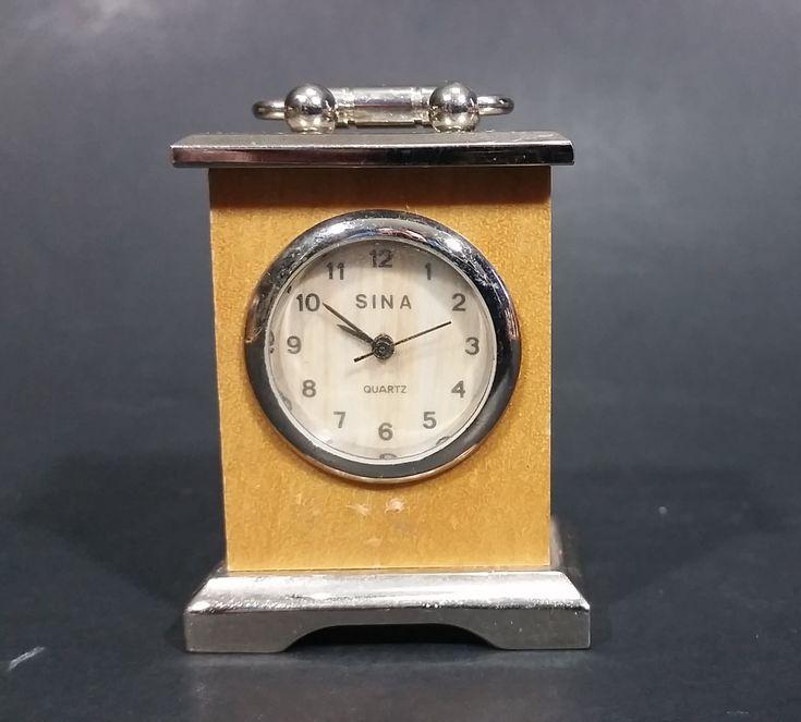 Sina Quartz Miniature Wood and Metal Case Miniature Carriage Clock https://treasurevalleyantiques.com/products/sina-quartz-miniature-wood-and-metal-case-miniature-carriage-clock #Sina #Quarts #Mini #Miniatures #Wood #Wooden #Metal #Carriage #Clocks #Collectibles #Smalls #Tiny #Little #Cute #Time #TimePiece #TickTock #Decor #Decorative #ShelfDecor #Decorations