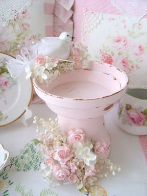 a flower pot and flower dish and embellish it. Beautiful!