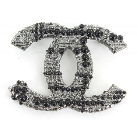 c3137a287dd broche chanel metal argente avec strass et perle noire