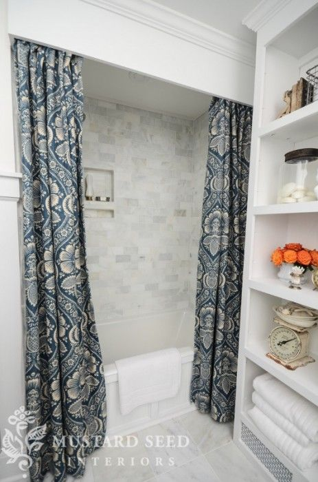 Terrific bathroom makeover...marble subway tile for shower, marble tile for floors, shower curtain with cornice, wood frame for tub, shelf unit, dresser turned into a vanity