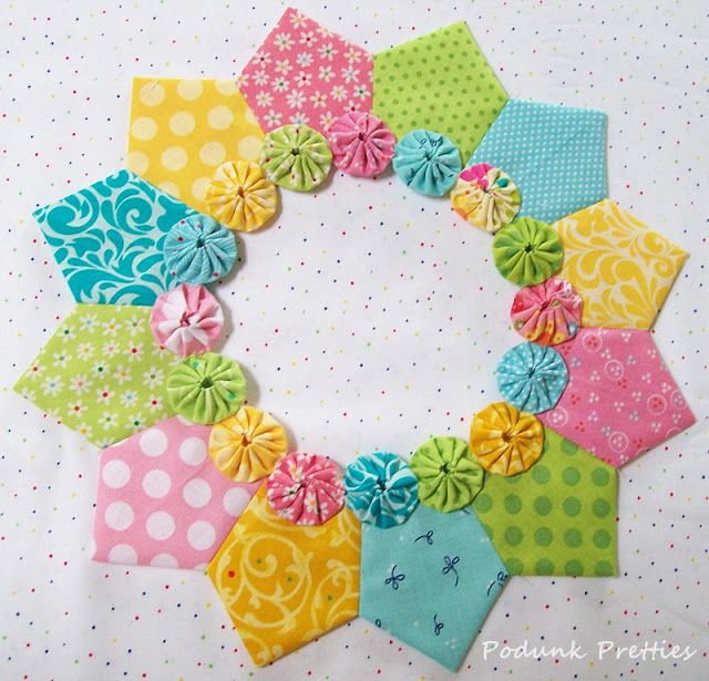 Whats not to love?  It has everything in a quilt that I love.  Pretty fabrics, flowers, applique and that level of cuteness that makes me smile everytime I look at the adorable blocks.    You might r