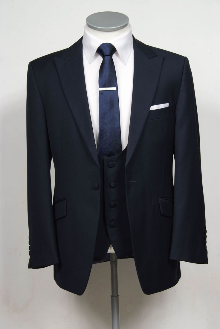 """grooms wedding suit in navy slim fit light weight wool with scoop neck waistcoat. Mens sizes from 32"""" chest upward and include extra short, short, regular, long and extra long fittings. Boys sizes from 20"""" to 34"""" chest. Complete outfit includes jacket, skinny trousers, hire or matching waistcoat, brand new traditional or French wing slim fit shirt in white or ivory, tie or cravat, braces and cufflinks. £150.00 to hire #groom #wedding #suit #hire #suithire #scoop #waistcoat #navy #groom"""