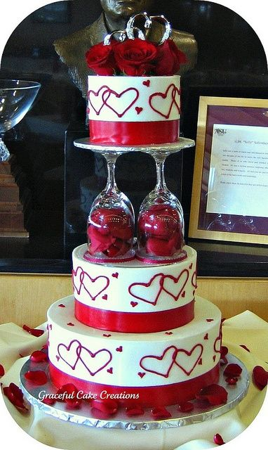 Elegant Valentine Wedding Cake Round Buttercream Wedding Cake with RedHearts Red Roses and Wine Glass Pillars from Graceful cake creations