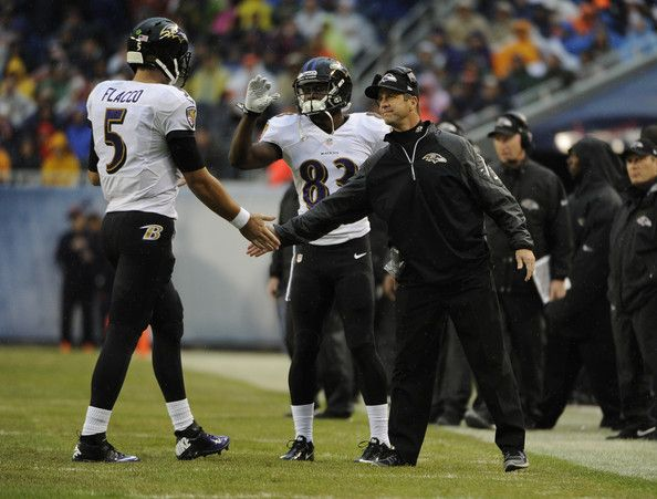 Head coach John Harbaugh of the Baltimore Raven congratulates Joe Flacco #5  after a Ravens touchdown against the Chicago Bears