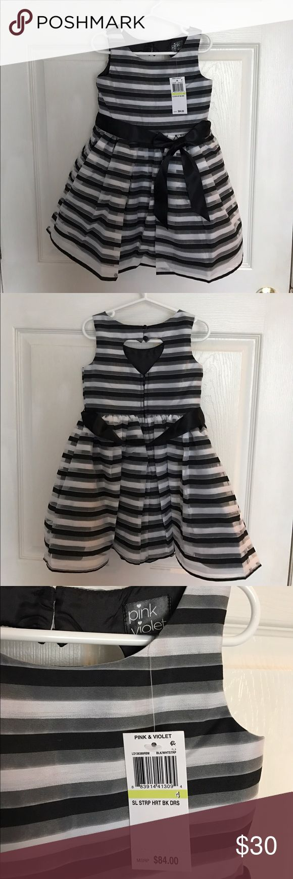 Girls striped heart back dress Girls size 4 black and white dress, sleeveless, ribbon/bow waist. Lining underneath. Zipper back with heart cut out. Brand: Pink & Violet. New With Tags. Pink & Violet Dresses Formal