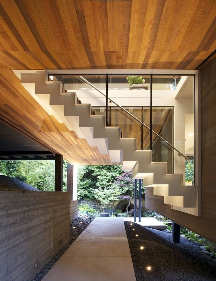 Southlands Residence by Dialog -- cool inside/outside contrast with the glass encased staircase