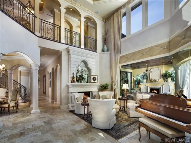 Two Story Formal Living Room With Fireplace Port Royal In Naples FL