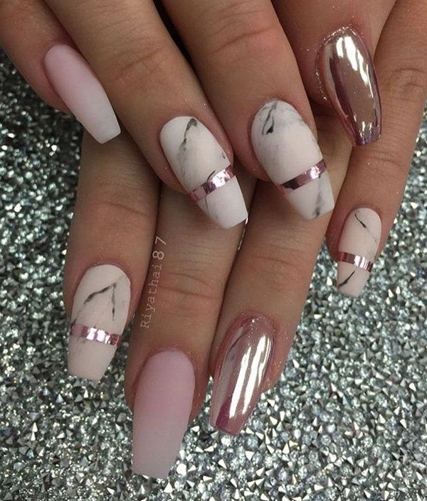 Here is a combination of matte color in marble design with glossy paint on one nail. So fine that you can see yourself in it.