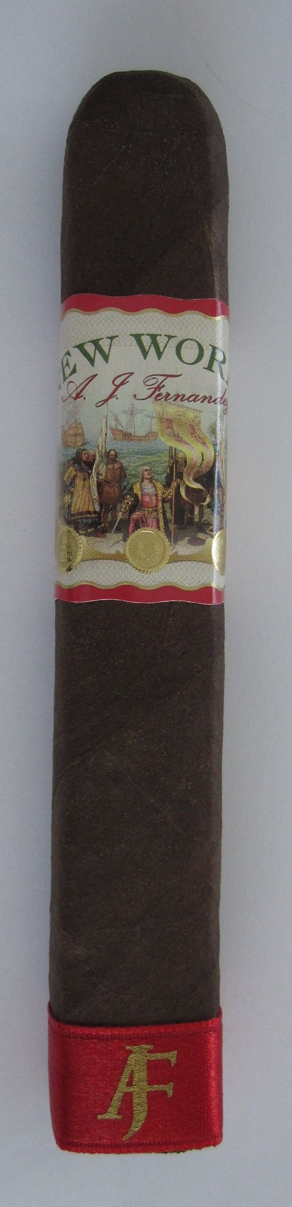 Review of New World Cigar by AJ Fernandez:  http://cigarczars.com/review/new-world-cigar.htm .