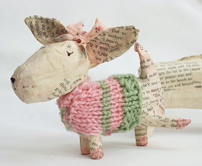 paper maché pieing dog, with knit sweater