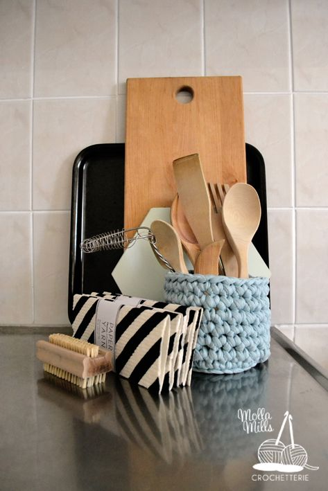 Crochet basket for wooden kitchen tools, printed decomposing dish cloths from Paper and Yarn collection.