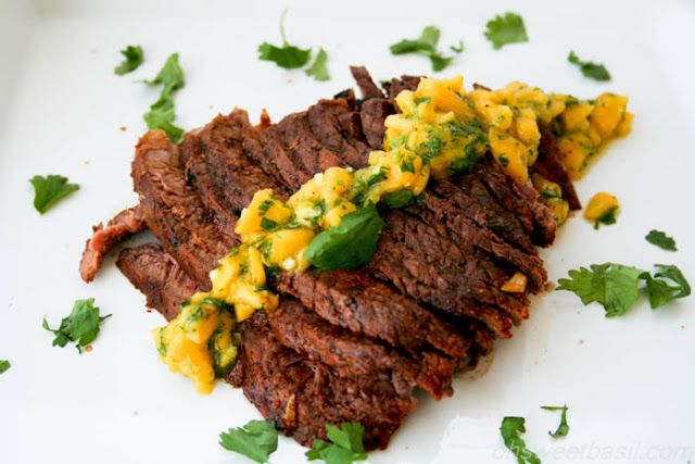 Grilled Flank Steak with Mango ChimiChurri. A delicious marinated flank steak paired with a sweet mango chimichurri. A great way to add a little pizzaz to your meat. ohsweetbasil.com