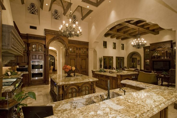 BEAUTIFUL!!! Such a massive size kitchen but with the colors of everything its still quite cozy.